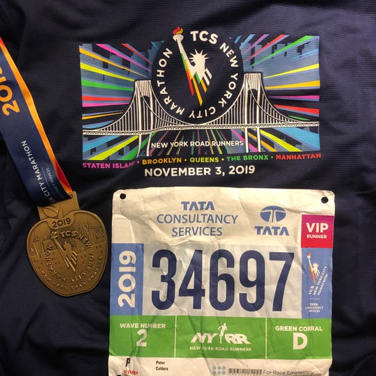Pete Caldera's medal and keepsakes from running the 2019 NYC Marathon.