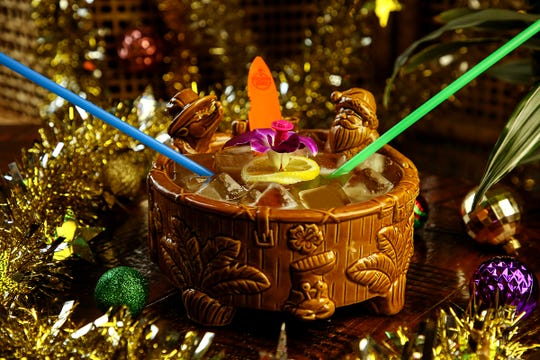 This rum bucket is meant to share, and comes in a hot-tub-like bowl with a Santa and reindeer.