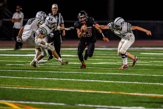 Enzo Arjona (13) and Northern Highlands are seeded No. 1 in the NJSIAA North 1, Group 4 football playoffs.