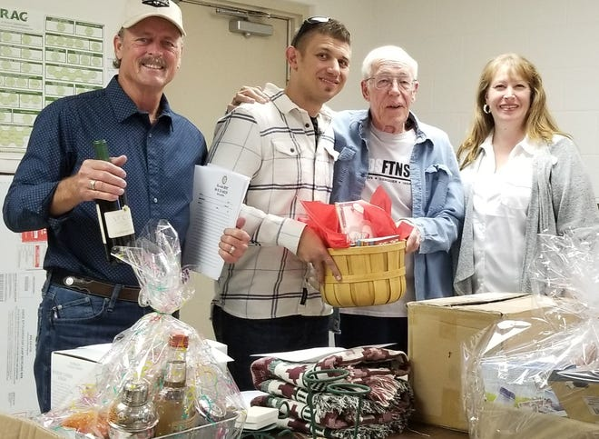 Deming Rotary Club President Jim Dye, left, collects donations for Thursday's silent auction with members Greg Morrow, Doc O'Connell and Heather Wood.