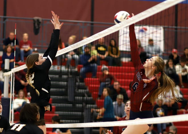 Junior Lady 'Cat Rachel Simpson, at right, led a strong hitting attack for the lady Wildcats in their victory over Alamogordo high on Saturday.