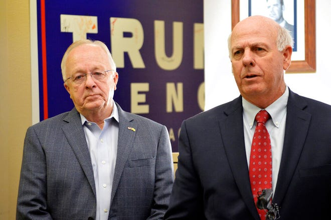 New Mexico Republican House Minority Leader James G. Townsend, left, and Republican Party of New Mexico chairman Steve Pearce, right, talk to reporters on Monday, Nov. 4, 2019, in Albuquerque after announcing the party will challenge how the state is counting absentee ballots.