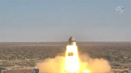 In this image made from a video provided by NASA Boeing tests the launch abort system of the Starliner capsule in White Sands Missile Range in N.M., on Monday, Nov. 4, 2019. The capsule carried no astronauts Monday morning, just a test dummy.