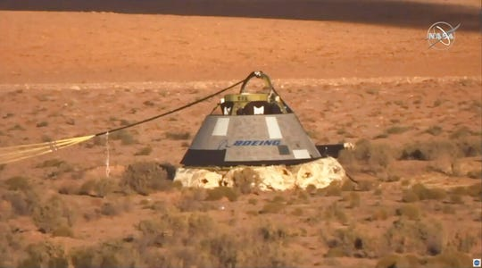 In this image made from a video provided by NASA the Starliner capsule rests on the ground after a test of Boeing's crew capsule's launch abort system in White Sands Missile Range in N.M., on Monday, Nov. 4, 2019. The capsule carried no astronauts Monday morning, just a test dummy.