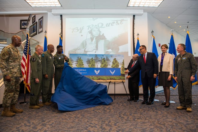Air Force Chief of Staff Gen. David L. Goldfein (far right), Secretary of the Air Force Barbara M. Barrett (second from right), relatives of Gen. Benjamin O. Davis Jr., Chief Master Sgt. of the Air Force Kaleth O. Wright (far left), Jay B. Silveria, U.S. Air Force Academy superintendent and other staff members unveil a mock-up of the Academy's new airfield sign Nov. 1, 2019. The Academy officially named its airfield in honor of Gen. Davis, an original Tuskegee Airman.