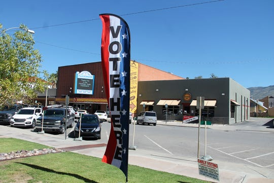 "A ""Vote Here"" sign in front of the Otero County Offices on New York Avenue"