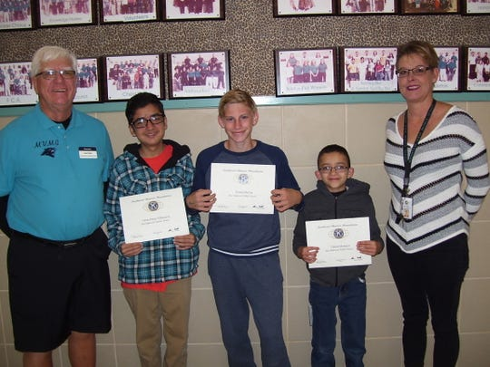 Alamogordo Kiwanis Club recognized October's most improved middle school students. From left: Ned Kline of Alamogordo Kiwanis,  eighth grader Oscar Parra-Villanueva, seventh grader Tanner McCoy, sixth grader Fabian Montoya, and Assistant Principal Alicia Edgin