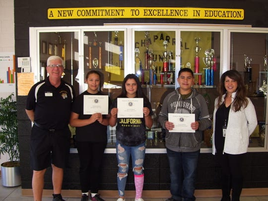Alamogordo Kiwanis Club recognized October's most improved middle school students. From left: Ned Kline of Alamogordo Kiwanis, sixth grader Julianna Barnwell,  seventh grader Alexis Rodriguez, eighth grader Vincent Porras, and Principal Cynthia Bond