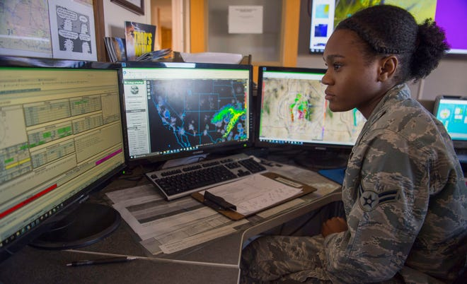 Airman 1st Class Mya Lewis, 54th Operations Support Squadron weather apprentice, monitors weather models, Oct. 24, 2019, on Holloman Air Force Base, N.M. The 54th OSS weather flight provides timely, accurate forecasts to base personnel so they can plan accordingly.