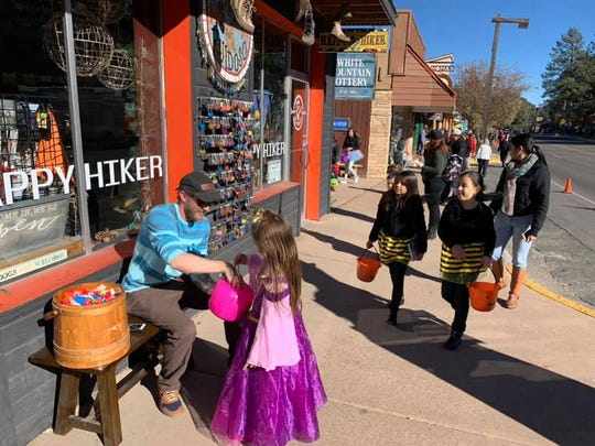 Children in costumes flocked to midtown Ruidoso on Halloween to stop at shops like the Happy Hiker to find treats.