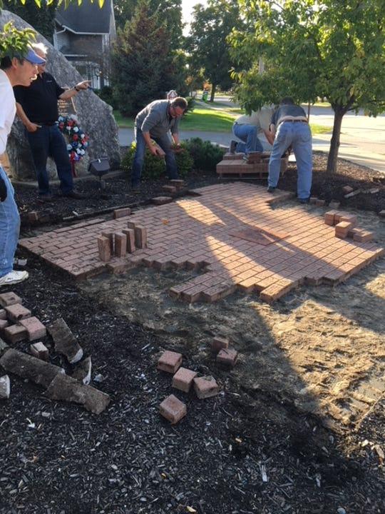 Legacy bricks are laid for the South Lyon Veterans Memorial at McHattie Park.