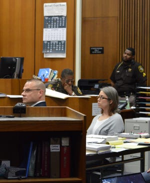 Former Westland Jail commander Ronald Buckley, far left, and former Westland paramedic Leah Maynard, behind him, went on trial Oct. 28, 2019, for alleged misconduct. A jury cleared Buckley. A mistrial was declared for Maynard.
