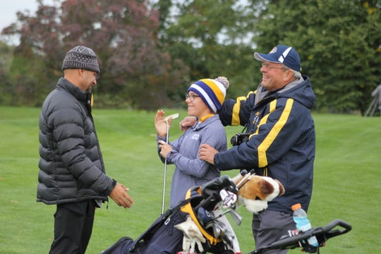 South Lyon freshman golfer Gabriella Tapp celebrates after securing the first individual state title in school history.