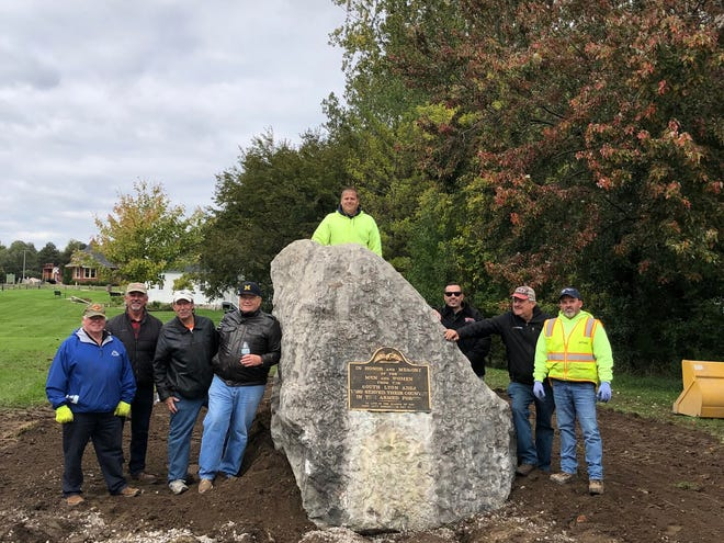 The crew which assisted with the move of the big rock in October 2019 to McHattie Park, the new location of the South Lyon Veterans Memorial. From left, Larry Ledbetter, Glenn Kivell, Phil Weipert, Bob Donohue, John Race (top of rock), Jeff Heinanen, Herb Stricker and Trevor Piasecki.