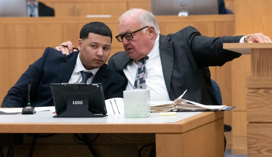 Defense Attorney Michael J. Griffith chats with his client, Markquise Wallace, during jury selection on Monday, Nov. 4, 2019.  Wallace is on trial for the hit and run deaths of two people on Cervantes Street in June of 2018.