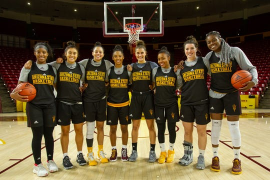 Members of the ASU women's basketball team pose for a photograph.