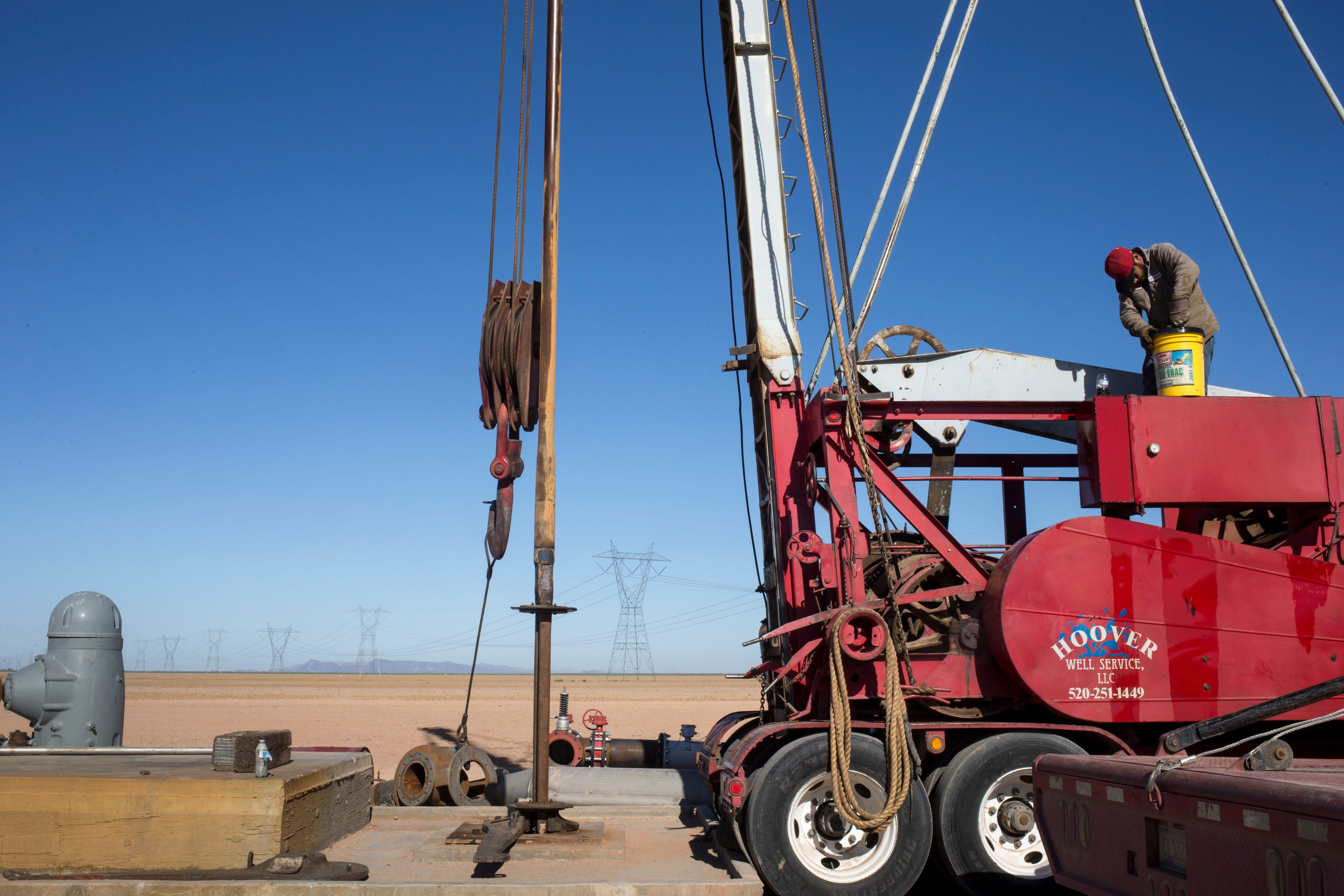 Freddie Sovero of Hoover Drilling Co. fills his drilling rig with fuel while working on a well near Hyder.