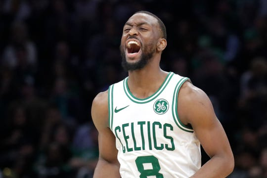 Boston Celtics guard Kemba Walker celebrates during the fourth quarter of the team's NBA basketball game against the New York Knicks, Friday, Nov. 1, 2019, in Boston. The Celtics won 104-102. (AP Photo/Elise Amendola)