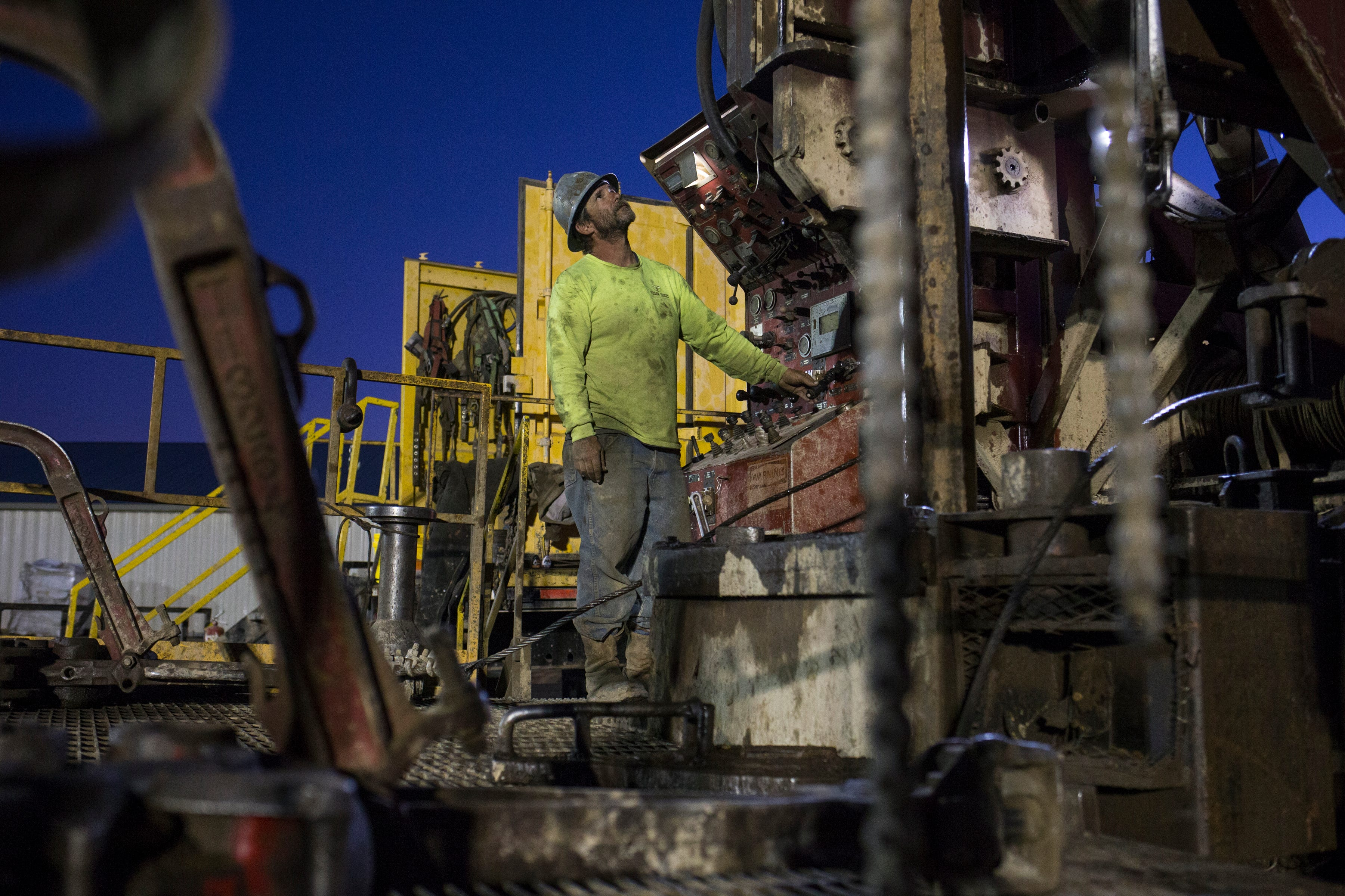 Bill Ryan of Yellow Jacket Drilling operates a drilling rig near Kingman, digging a 1,300-foot well for Peacock Nuts.