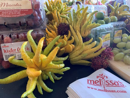 Buddha's Hands fruit on display at the Melissa's Specialty Produce booth inside the VIP tent.