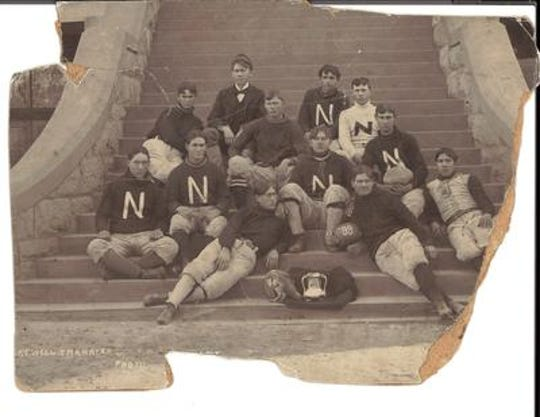 Tempe Normal's 1899 football team poses with the Territorial Cup on the steps of Old Main.