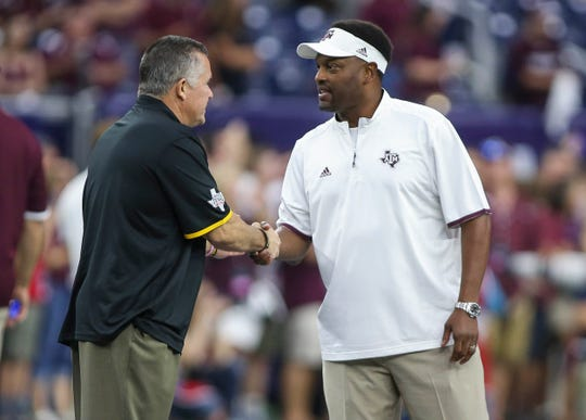 Arizona State Sun Devils head coach Todd Graham and Texas A&M Aggies head coach Kevin Sumlin shake hands before a game at NRG Stadium in 2015.