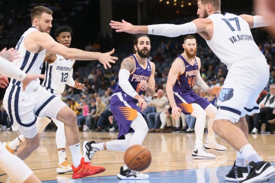Phoenix Suns guard Ricky Rubio (11) passes while center Aron Baynes (46) looks on as Memphis Grizzlies guard Marko Guduric (23) and center Jonas Valanciunas (17) defend at FedExForum. Phoenix won 114-105.