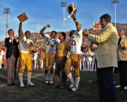 ASU coach Frank Kush and his players celebrate their 1975 Fiesta Bowl win over Nebraska, capping a 12-0 season.