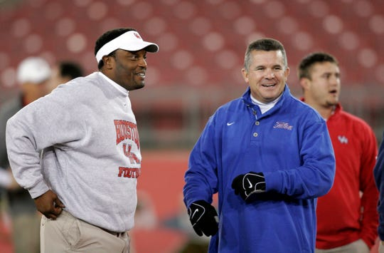 Houston Cougars head coach Kevin Sumlin talks with Tulsa Golden Hurricane head coach Todd Graham before a game at Robertson Stadium in 2008.