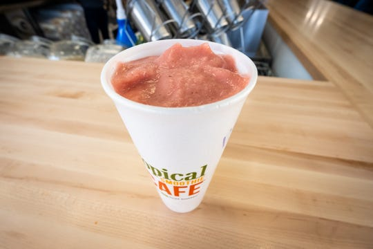 A Paradise Point smoothie waits on the counter at Tropical Smoothie Cafe in Port Huron. In addition to smoothies, the restaurant also offers supplements and other add-ins to its smoothies.