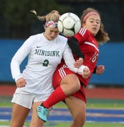 Minisink Valley's Mia Macaluso, left, fights for the ball with Red Hook's Ari Safaryan during the Section 9 Class A girls soccer final at Middletown. Nov. 4, 2019. Minisink won 2-1.