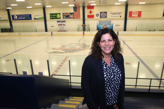 Mid-Hudson Civic Center president Danielle Anderson inside the McCann Ice Arena on November 1, 2019. Over the summer of 2019 the arena was renovated including  fresh paint for the bleachers, leveling the concrete under the ice, repairing some of the boards around the rink, and the creation of a new logo for under the ice.