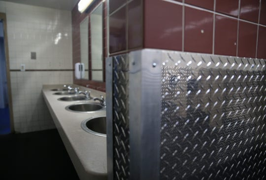 Diamond plate steel was added to the walls inside rest rooms in the McCann Ice Arena  to prevent damage to the walls by skaters.
