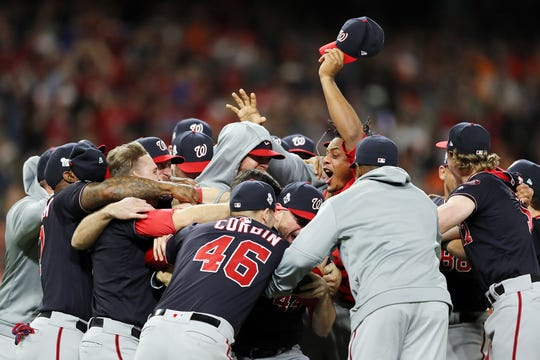 The Washington Nationals celebrate after defeating the Houston Astros, 6-2, in Game 7 of the World Series at Minute Maid Park in Houston on Wednesday, Oct. 30, 2019. The Nationals won, 6-2. (Elsa/Getty Images/TNS)