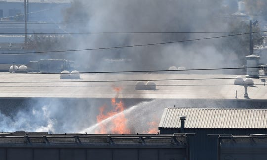 Sparks fire department works a fire at an abandoned building in the Sparks industrial area on Monday morning Nov. 4, 2019.