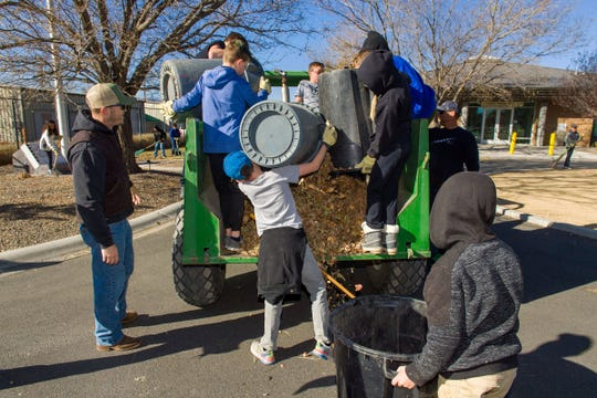Fifth- and sixth-grade students in the Fernley Intermediate School leadership program dump buckets of leaves as part of a clean-up project at the Northern Nevada Veterans Memorial Cemetery.