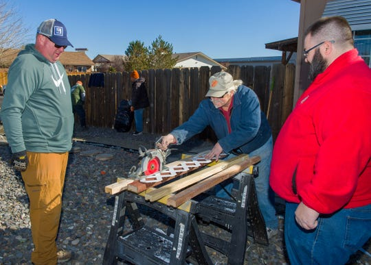 """Home Depot employees volunteered as part of the company's """"Celebration of Service"""" program to fix fencing, repair a wheelchair ramp and install air conditioning at the home of Fernley veteran Martin Harka, who served in the Korean and Vietnam wars."""