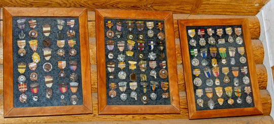Paul Lunsford, who served in the Korean War, has a collection of ribbons and pins on display.