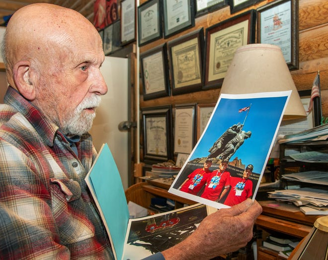Paul Lunsford of Yerington, a Navy veteran who served in the Korean War, shows a photo from the Honor Flight he was part of a few years ago.