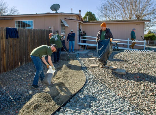 Volunteers from the Home Depot Foundation xeriscape the front yard and make repairs to the Fernley home of Martin Harka, a veteran of the Korean and Vietnam wars.