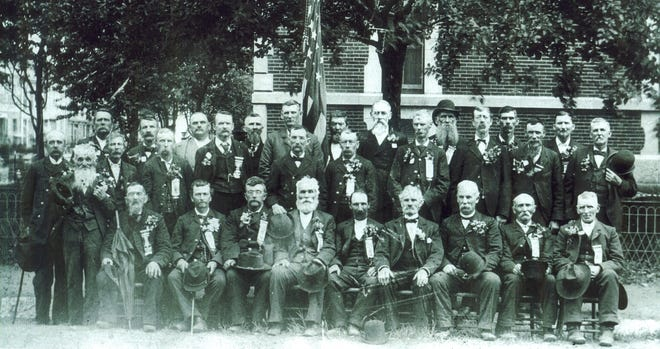 Unidentified elder Civil War veterans at a Centerville reunion look out at the camera taking their picture… seemingly at us.