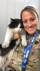 Army Maj. Lindsay Gaylord and cat Moonpie, whom she rescued in Kabul, Afghanistan, while recently deployed there.
