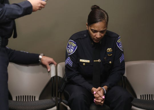 Rochester Police Sgt. Kara Anglin sits quietly before the start of the press conference about the cause of Rochester Police Officer Manny Ortiz's death.