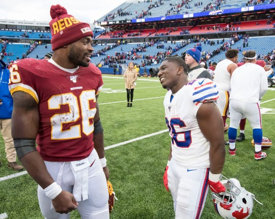 Nov 3, 2019; Orchard Park, NY, USA; Washington Redskins running back Adrian Peterson (26) and Buffalo Bills running back Devin Singletary (right) greet one another after a game at New Era Field.