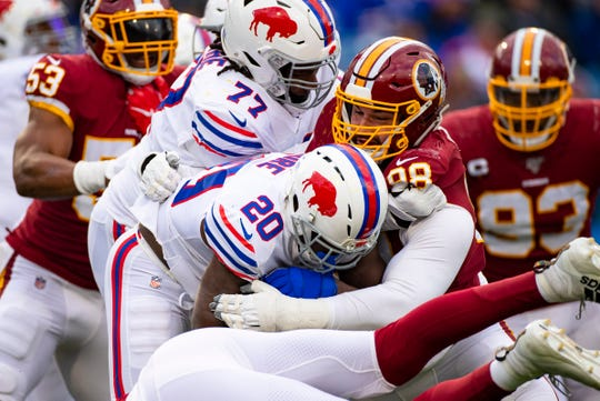 Matthew Ioannidis #98 of the Washington Redskins stops Frank Gore #20 of the Buffalo Bills on a carry during the third quarter at New Era Field.