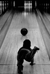 Two-year-old Gina Quattrocchi puts her weight into her shot in a Peewee League at Brighton Bowl in 1982.