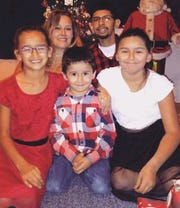 Santiago Amaya, 31, with his family on during the holidays.