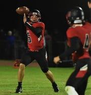 James M. Bennett quarterback Sam Blackmon looks to pass on Friday, Nov. 1, 2019.