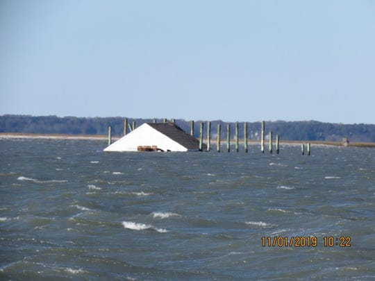 This building was floating away near Chincoteague, Virginia after it apparently was knocked off its pilings during high winds Thursday night, Oct. 31, 2019.