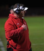 James M. Bennett offensive coordinator Dustin Mills watches from the sidelines as his team battles Wi-Hi on Friday, Nov. 1, 2019.